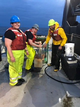 Gabriella, in front, sampling benthic invertebrates on the Great Lakes from the R/V Lake Guardian with Susan Daniel and Toby Holda